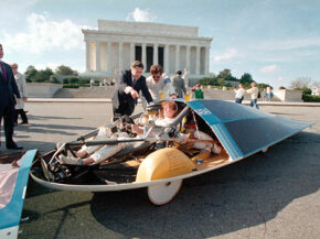 Energy Secretary John Herrington, left, points to a component of the solar-powered GM Sunraycer while co-driver Molly Brennan of Waterford, Mich., sits in the cockpit in Washington, D.C., Nov. 18, 1987.