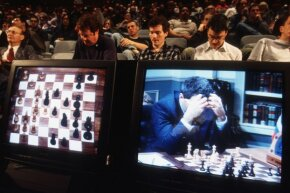 The match between Kasparov and IBM's Deep Blue in 1997 was telecast to auditoriums for chess and computer fans to watch.
