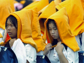 School children participate in a disaster drill in 2004 in Japan. The drills, involving some 2 million people, are held every Sept. 1 on the anniversary of the massive 1923 earthquake that killed more than 140,000 people in the Tokyo area.