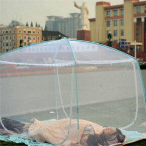 A resident sleeps outdoors at the Tianfu Square to avoid earthquke aftershocks on May 22, 2008, in Chengdu of Sichuan Province, China. More than 51,000 people have been confirmed killed in the May earthquake.