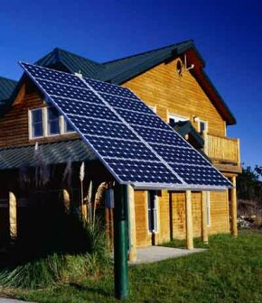 Sustainable communities design their houses to be energy efficient, like this house with solar panels.