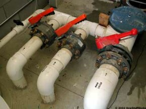 Pipes from the main drain, skimmer and vacuum ports lead to the pumping system.
