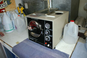 An autoclave sterilizes tattoo equipment before each use.