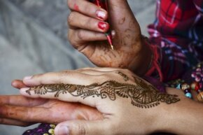 Henna tattoos are painted with a henna plant paste and have an earthy smell.