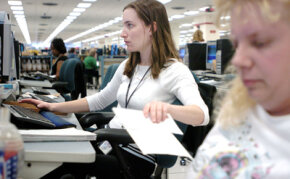 Mary Kersey transcribes data from tax returns at the Cincinnati Internal Revenue Service Center on April 8, 2005, in Covington, Kentucky.