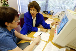 A financial advisor can help you make decisions about mutual funds. See more ­investing pictures.