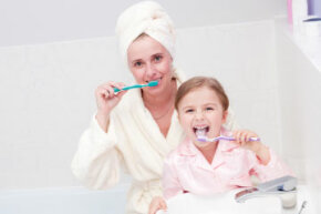 Monkey see, monkey do. Keep a family brushing schedule, and make it a habit to brush with your little one -- seeing a parent brush regularly reinforces oral hygiene lessons.