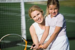 When teaching kids tennis, start by letting them hit balls with a racquet so they learn the feel.