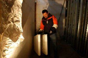 Housing developer Scott Chrisner demonstrates the ICF wall, special foam-insulation blocks with concrete poured inside.