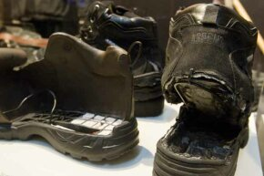 The shoes used in Richard Reid's failed attempt to blow up an airplane (R) are displayed with an FBI model of the shoe filled with explosives as part of an exhibit marking the 10th anniversary of the 9/11 attacks, at the Newseum in Washington, D.C.