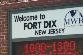 A welcome sign sits at the entrance to Fort Dix military base in New Jersey.