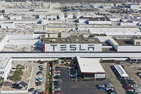 The Tesla Motors factory shown here sprawls across Fremont, California. Tesla plans to open another factory in Nevada that could begin production in 2017.
