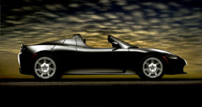 The Tesla Roadster is a high-performance electric car that may rival future 100 mpg cars. Its manufacturer claims it can travel 100 miles for much less than the price of a gallon of gas.