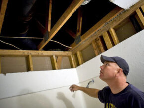 Norhtwoods subcontractor Doug Jollenbeck repairs mold damage in Sacramento, Calif.
