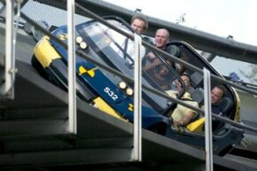 Guests ride the Test Track at Disney's Epcot Center. The ride lets them feel the effects of high-speed braking.