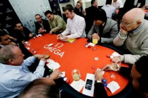 Focused players at a Texas Hold 'em tournament.