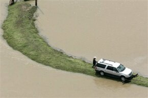 The torrential rainstorms in Texas made entire roads disappear under water.