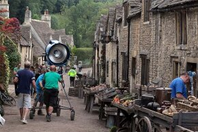 A film crew moves lights on the set of 'War Horse' which was filmed in Chippenham, England in 2010. It helps to have muscles on a film set. See more in our movie-making image gallery.