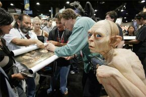 'Lord of the Rings' special effects artist Richard Taylor signs autographs for fans at Comic Con in 2003. You can bet the rotoscope on that film was done by someone else.