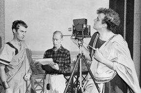 Movie director David Bradley, in costume as Brutus, checks the camera angle for a shot of Grosvenor Glenn, playing Cassius, as assistant director Thomas A. Blair checks the script during filming of the 1950 movie 'Julius Caesar.'