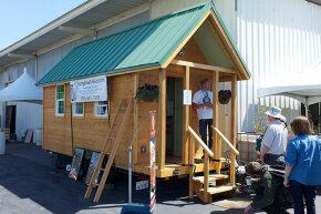 People visit a Tumbleweed Tiny House at the 2012 Maker Faire in San Mateo, California.