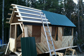 A roof goes up on a tiny house.