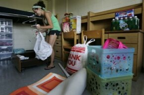 An undergraduate at New Jersey's Seton Hall University unpacks her gear for the year. The big question: Where is she going to stick her toiletries?