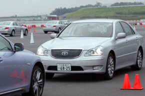 A Toyota equipped with the latest safety technology stops near another car to avoid a collision during its test run at the Toyota Safety Education Center near Tokyo. Toyota developed a system for detecting rear-end collisions before they happen.