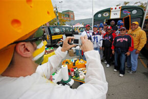 Fans tailgate before an NFL football game between the Green Bay Packers and the Buffalo Bills in Green Bay, Wis.