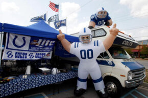 A large Colts inflatable player can be seen as fans tailgate in the parking lots outside of Lucas Oil Stadium prior to the preseason game between the San Francisco 49ers and the Indianapolis Colts in Indianapolis, Ind.
