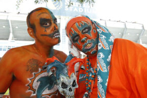 Manny Lopez (left) and Shane Meyers, members of the Dolphin Bandits, tailgate prior to the game between the Miami Dolphins and the New York Jets at Sun Life Stadium in Miami, Fla.