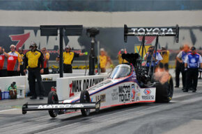 Driver Antron Brown launches the Matco Tools Top Fuel dragster at the zMAX Dragway in Concord, North Carolina.