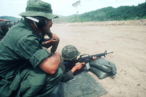 An unidentified American official trains Honduran soldiers in June 1983.