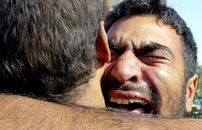 An Iraqi man hugs his brother in November 2005 after being freed from Abu Ghraib prison, a site where some prisoners were tied up, hooded and sexually degraded by the American military.
