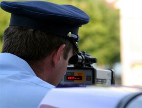 Be careful of police officers using radar guns or lidar to catch speeders. Often they will be positioned in a parking lot on the side of a road or around a bend in a highway.