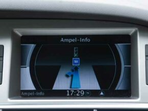 This Audi multimedia interface screen displays Travolution information for drivers. If they maintain a speed of 31 mph (50 kph), then they'll coast through a green light -- even if the light is currently red.