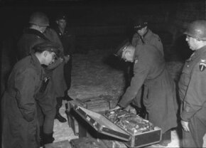 General Dwight Eisenhower inspects Nazi gold uncovered by Allied forces in 1945.