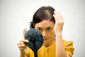 Does our society have a bias against bald or balding women? See more pictures of skin and scalp problems.
