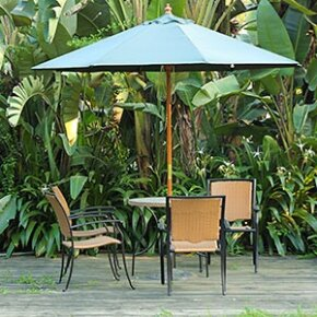 Lush plants and natural materials are the foundations for a tropical space.