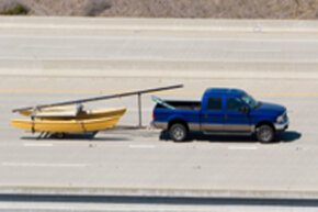 Before you drive off with a boat in tow, you need to make sure its weight is within your truck's towing capacity.