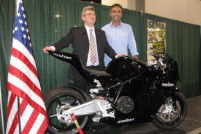 John Schimmin, the Isle of Man Environment Minister (left), and Azhar Hussain, founder of the TTXGP (right), behind the Mavizen electric motorcycle.