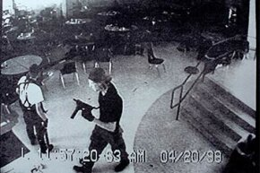 Columbine High School shooters Eric Harris (L) and Dylan Klebold appear in this video-capture of a surveillance tape in the cafeteria of Columbine High. The school shooting has been cited as 'inspiration' for copycat criminals.