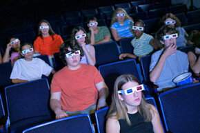 Theaters have turned to digital 3-D to give movie fans a reason to come back to the theater.