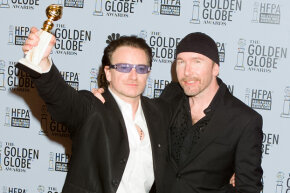 U2's Bono, left, and The Edge following their acceptance speech at the 60th Annual Golden Globe Awards on Jan. 19, 2003.