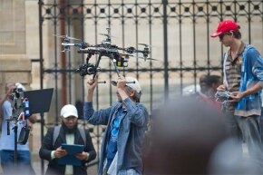A journalist operates a drone outside the Pretoria High Court on in Pretoria, South Africa during the trial of Oscar Pistorius.
