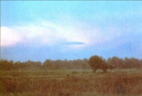 This lenticular cloud was photographed over Kepala Batas, Malaysia, in November 1984. Many UFO sightings can indeed be explained as natural occurrences.