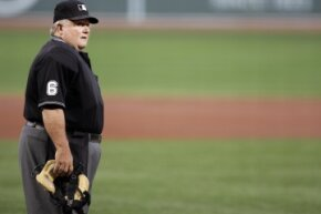 Bruce Froemming looks into the stands on Aug. 16, 2006, before he umpires his 5,000th game of his major league career. He joined Hall of Famer Bill Klem as the only other umpire to reach that milestone.
