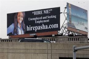 Pasha Stocking of East Hampton, Conn. promotes herself along I-95.