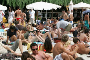 Hot humid places, like this beach in Ibiza, Spain, are a perfect breeding ground for sweat rash. View more men's health pictures.