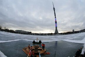 People gather to immerse themselves in an ice hole near the Ostankino television tower during celebrations for Russian Orthodox Epiphany in Moscow, 2015. A similar radio tower north of Moscow transmitted strange beeps and buzzes in the 1980s and '90s.